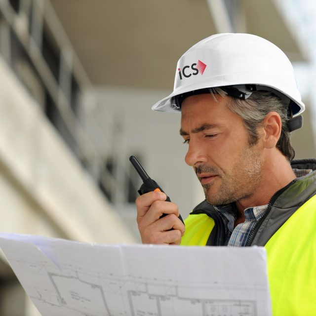 Portrait of construction manager using walkie-talkie